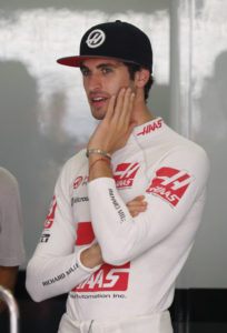 Haas reserve driver Antonio Giovinazzi of Italy stands at his team's garage during the first practice session for the Malaysian Formula One Grand Prix at Sepang International Circuit in Sepang, Malaysia, Friday, Sept. 29, 2017. (AP Photo/Vincent Thian)