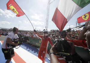 Ferrari driver Sebastian Vettel of Germany celebrates after winning the British Formula One Grand Prix at the Silverstone racetrack, Silverstone, England, Sunday, July 8, 2018. (AP Photo/Luca Bruno)