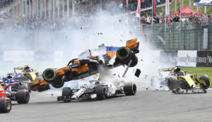 The car of Mclaren driver Fernando Alonso of Spain, center top, is involved in a crash along with Sauber driver Charles Leclerc of Monaco. center bottom, during the Belgian Formula One Grand Prix in Spa-Francorchamps, Belgium, Sunday, Aug. 26, 2018. (AP Photo/Geert Vanden Wijngaert)