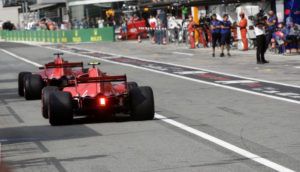 Ferrari driver Sebastian Vettel of Germany steers his car followed by Ferrari driver Kimi Raikkonen of Finland during the qualifying session at the Monza racetrack, in Monza, Italy, Saturday, Sept. 1, 2018. The Formula One race will be held on Sunday. (AP Photo/Luca Bruno, Pool)