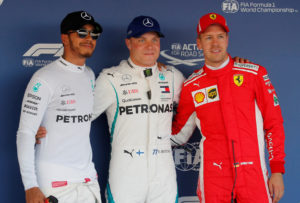 Formula One F1 - Russian Grand Prix - Sochi, Russia - September 29, 2018 Mercedes' Valtteri Bottas (C) after qualifying in pole position with teammate Lewis Hamilton (L), who qualified second and Ferrari's Sebastian Vettel, who qualified third REUTERS/Maxim Shemetov