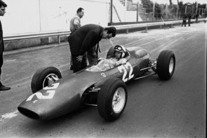 British driver John Surtees at the wheel of the new eight cylinder Italian Ferrari car, with which he will compete in the April 12, 1964 Syracuse Grand Prix Formula One Auto Race. (AP Photo/Girolamo di Majo)