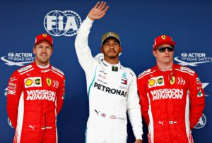 AUSTIN, TX - OCTOBER 20: Top three qualifiers Lewis Hamilton of Great Britain and Mercedes GP, Sebastian Vettel of Germany and Ferrari and Kimi Raikkonen of Finland and Ferrari celebrate in parc ferme during qualifying for the United States Formula One Grand Prix at Circuit of The Americas on October 20, 2018 in Austin, United States. Will Taylor-Medhurst/Getty Images/AFP == FOR NEWSPAPERS, INTERNET, TELCOS & TELEVISION USE ONLY ==