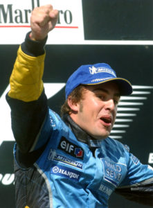 Spanish F1 driver Fernando Alonso of Renault clenches his fist as he celebrates on the podium after he won the Formula One Hungarian Grand Prix on the Hungaroring circuit, in Mogyorod, north-east of Budapest, Hungary, on Sunday, Aug. 24, 2003. (AP Photo/MTI, Imre Foeldi)