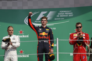 Red Bull driver Max Verstappen of the Netherlands, center, celebrates winning the Formula One Mexico Grand Prix auto race at the Hermanos Rodriguez racetrack in Mexico City, Sunday, Oct. 29, 2017. At left is Mercedes driver Valtteri Bottas, of Finland, who placed second, and at right is Ferrari driver Kimi Raikkonen, of Finland, who placed third. (AP Photo/Moises Castillo)