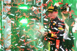 TOPSHOT - Red Bull's Dutch driver Max Verstappen celebrates on the podium after winning the F1 Mexico Grand Prix, at the Hermanos Rodriguez circuit in Mexico City on October 28, 2018. - Mercedes' British driver Lewis Hamilton became only the third Formula One driver in history to capture a fifth world title on Sunday as Max Verstappen won the Mexican Grand Prix. (Photo by ULISES RUIZ / AFP)