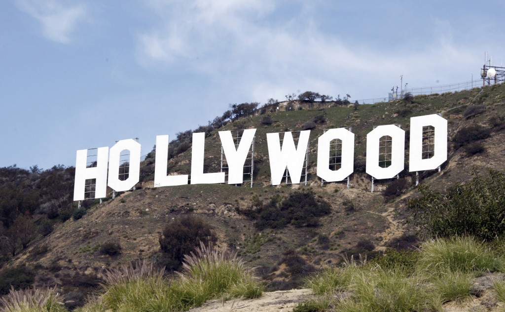 ap foto : reed saxon : file - this file photo taken friday jan. 29,2010, shows the hollywood sign near the top of beachwood canyon adjacent to griffith park in the hollywood hills of los angeles. ktla-tv reported wednesday, may 25, 2016, that youtube prankster vitaly zdorovestskiy was arrested after climbing the sign. (ap photo/reed saxon, file) jan. 29, 2010 file phot hollywood sign pran automatarkiverad