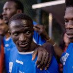 Malang Sadio från Senegal och Madi Sissoko från Elfenbenskusten laddar för match mot Roms polisstudenter, ett stenkast från Stadio Olimpico där Serie A-klubbarna Roma och Lazio spelar sina hemmamatcher.