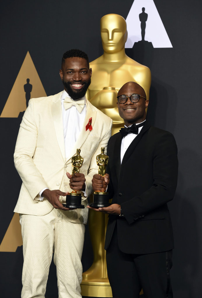 """Tarell Alvin McCraney, left, and Barry Jenkins, winners of the award for best adapted screenplay for """"Moonlight"""", pose in the press room at the Oscars on Sunday, Feb. 26, 2017, at the Dolby Theatre in Los Angeles. (Photo by Jordan Strauss/Invision/AP)"""