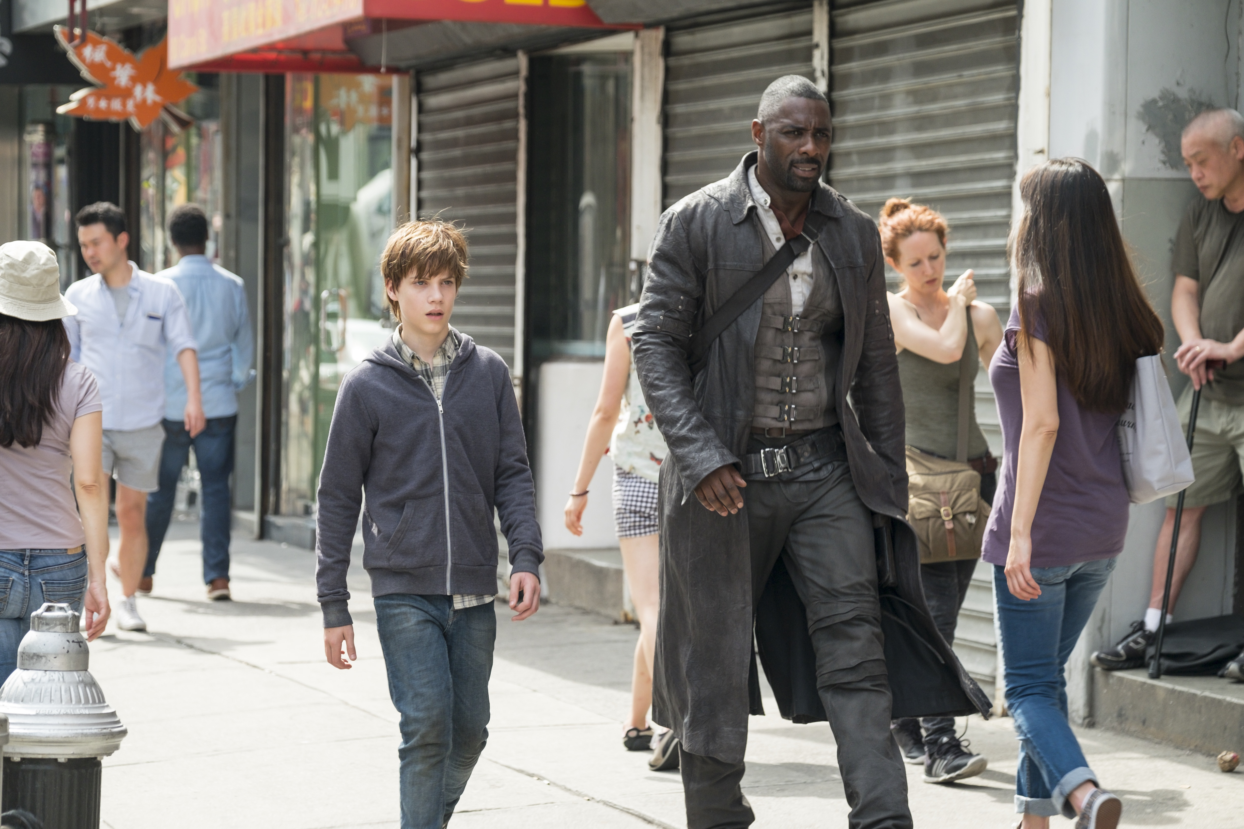 Jake Chambers (Tom Taylor) and Roland (Idris Elba) in Columbia Pictures' THE DARK TOWER.