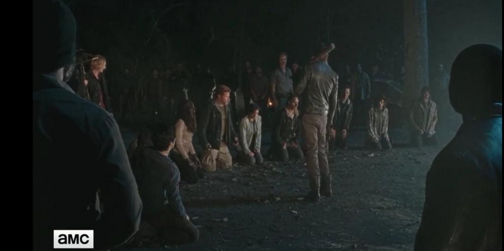 På knäna för Negan.