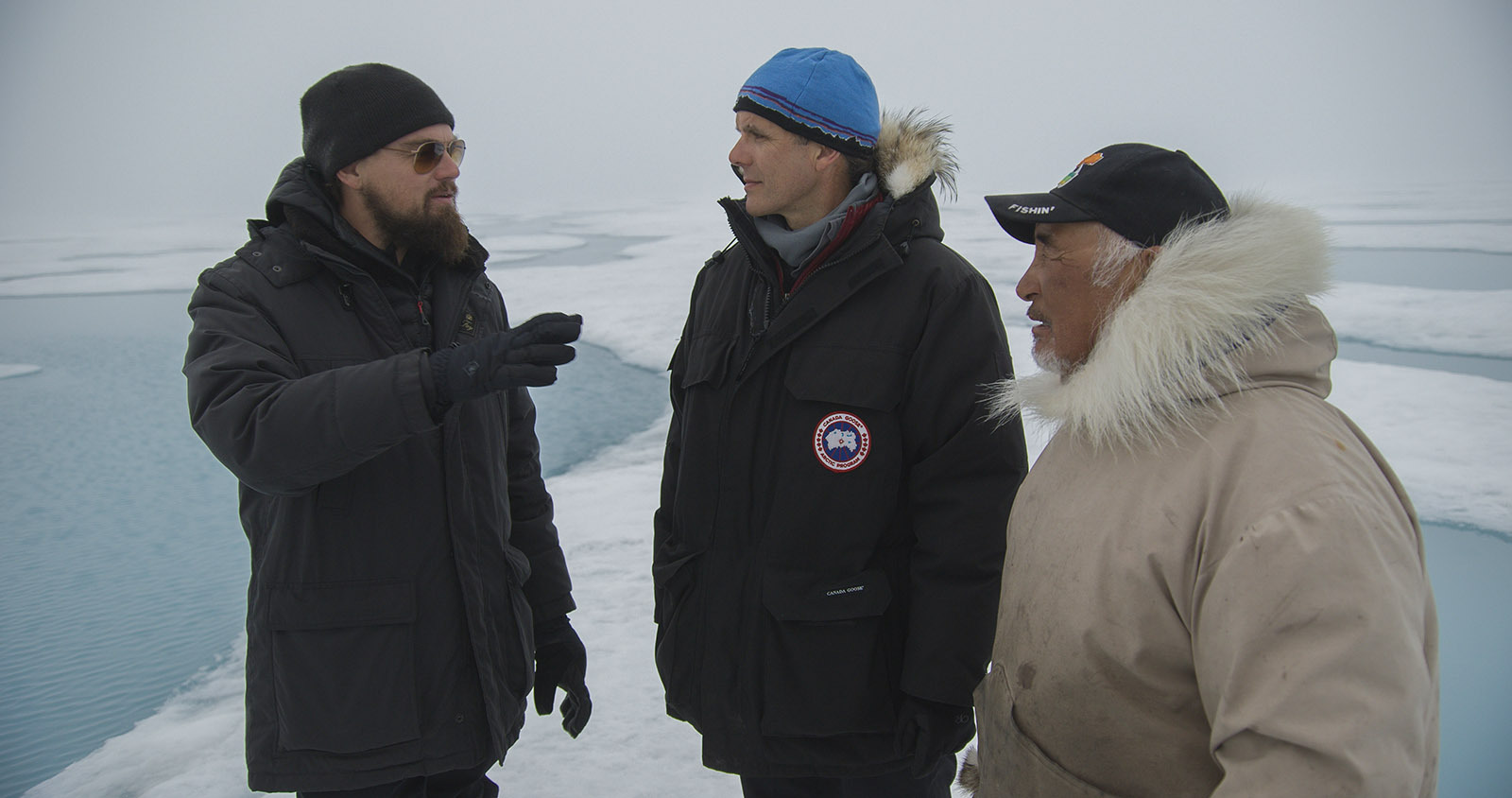 BAFFIN ISLAND, CANADIAN ARCTIC - (From left to right):  Leonardo DiCaprio, Enric Sala, National Geographic Explorer-in-Residence, and Jake Awa, Arctic Guide, Pond Inlet.  For two years, Leonardo DiCaprio has criss-crossed the planet in his role as UN messenger of Peace on Climate Change. This film, executive produced by Brett Ratner and Martin Scorsese, follows that journey to find both the crisis points and the solutions to this existential threat to human species.  The climate change feature documentary 'Before the Flood' airs globally on the National Geographic Channel October 30.(photo credit:  © 2016 RatPac Documentary Films, LLC and Greenhour Corporation, Inc.)