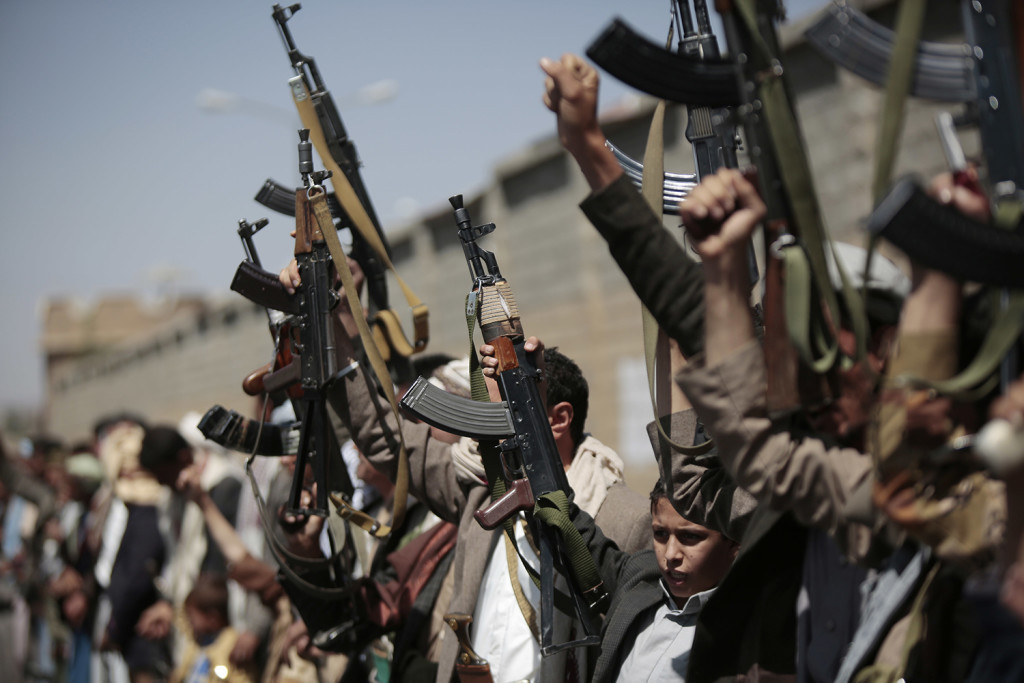Tribesmen loyal to Houthi rebels, hold their weapons as they chant slogans during a gathering aimed at mobilizing more fighters into battlefronts in several Yemeni cities, in Sanaa, Yemen, Sunday, Oct. 2, 2016. (AP Photo/Hani Mohammed)