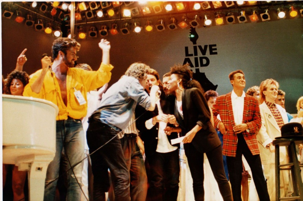 ap **file** british and irish singers perform on stage at the live aid concert at wembley stadium, london, england, on july 13, 1985.  from left are george michael of wham,  bob geldolf, bono of u2, freddie mercury of queen, andrew ridgley of wham! and howard jones. it may be hard for next month's live 8 concert to be as historic or even heart-warming as the 1985 live aid show, one of the greatest rock concerts of all time.  (ap photo) a july 13 1985 file photo  music live aid automatarkiverad