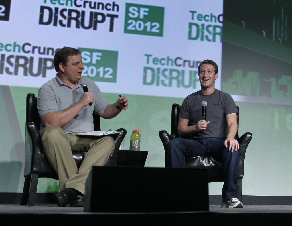 "Facebook CEO Mark Zuckerberg, right, listens to a question from moderator Michael Arrington, left, during a ""fireside chat"" at a conference organized by technology blog TechCrunch in San Francisco, Tuesday, Sept. 11, 2012.  Zuckerberg gave his first interview since the company's rocky initial public offering in May. (AP Photo/Eric Risberg) / SCANPIX Code: 436"