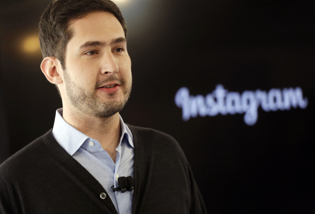 Instagram co-founder Kevin Systrom introduces a new feature, Instagram Direct, that lets users share photos and videos with up to 15 people rather than everyone who follows them on the popular photo-sharing app, at a news conference, Thursday, Dec. 12, 2013 in New York. (AP Photo/Mark Lennihan) / TT / kod 436