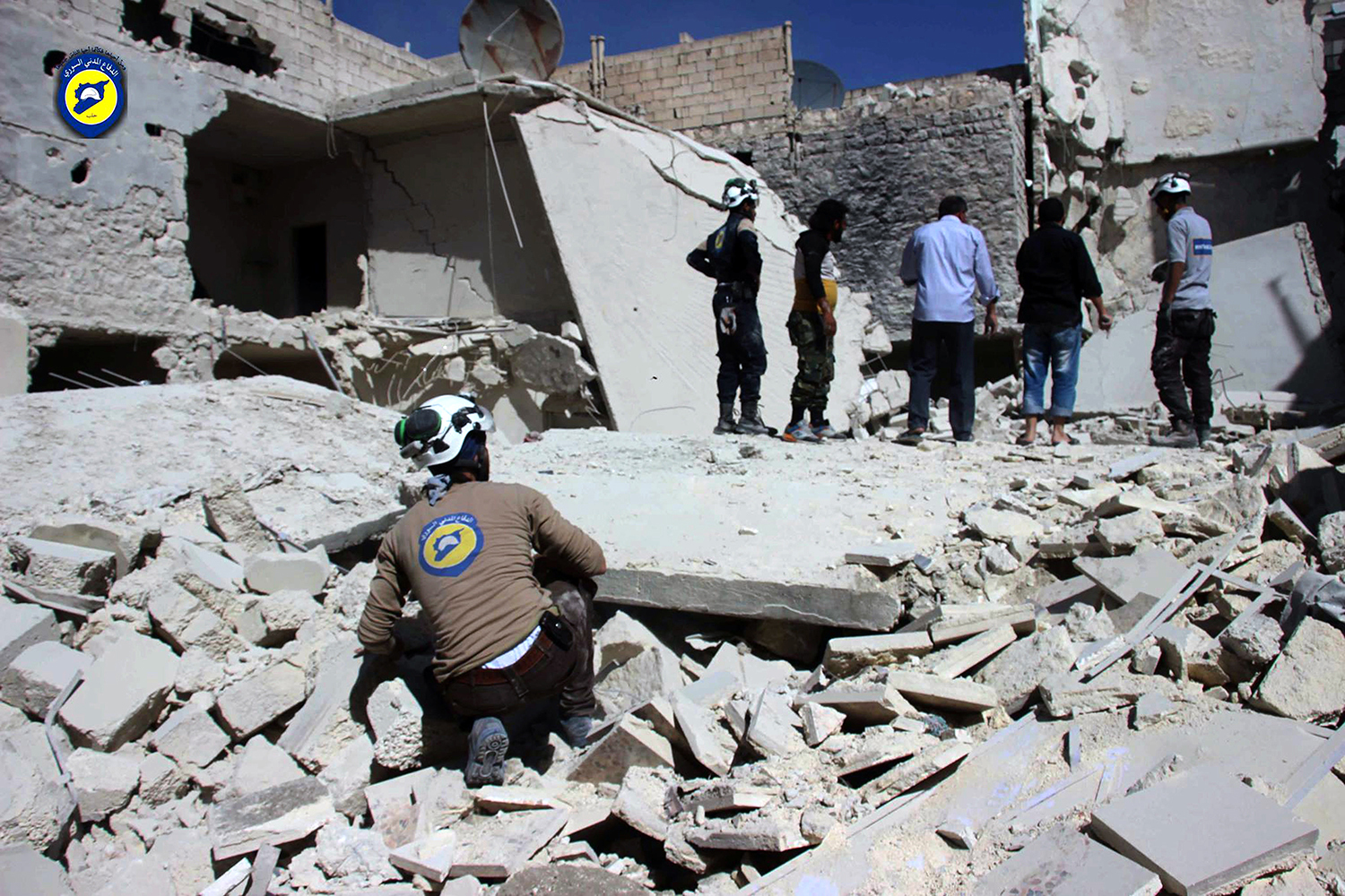 "This photo provided by the Syrian Civil Defense group known as the White Helmets, shows members of Civil Defense inspecting damaged buildings after airstrikes hit the Bustan al-Qasr neighborhood of Aleppo, Syria, Sunday, Sept. 25, 2016. A broad coalition of Syrian rebels denounced international negotiations for peace as ""meaningless"" on Sunday, as the U.N. Security Council prepared to convene an emergency meeting about the spiraling violence in Syria. (Syrian Civil Defense White Helmets via AP)"