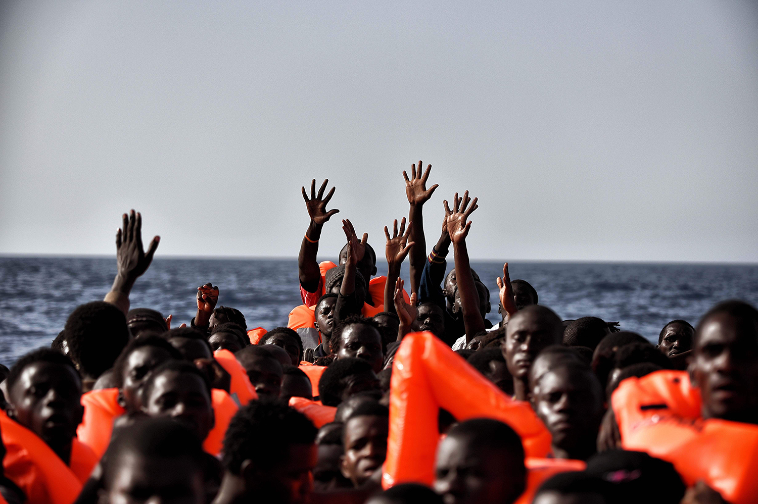 Migrants wait to be rescued in the mediteranean sea some 20 nautical miles north off the coast of Libya on October 3, 2016. / AFP PHOTO / ARIS MESSINIS / TT / kod 444