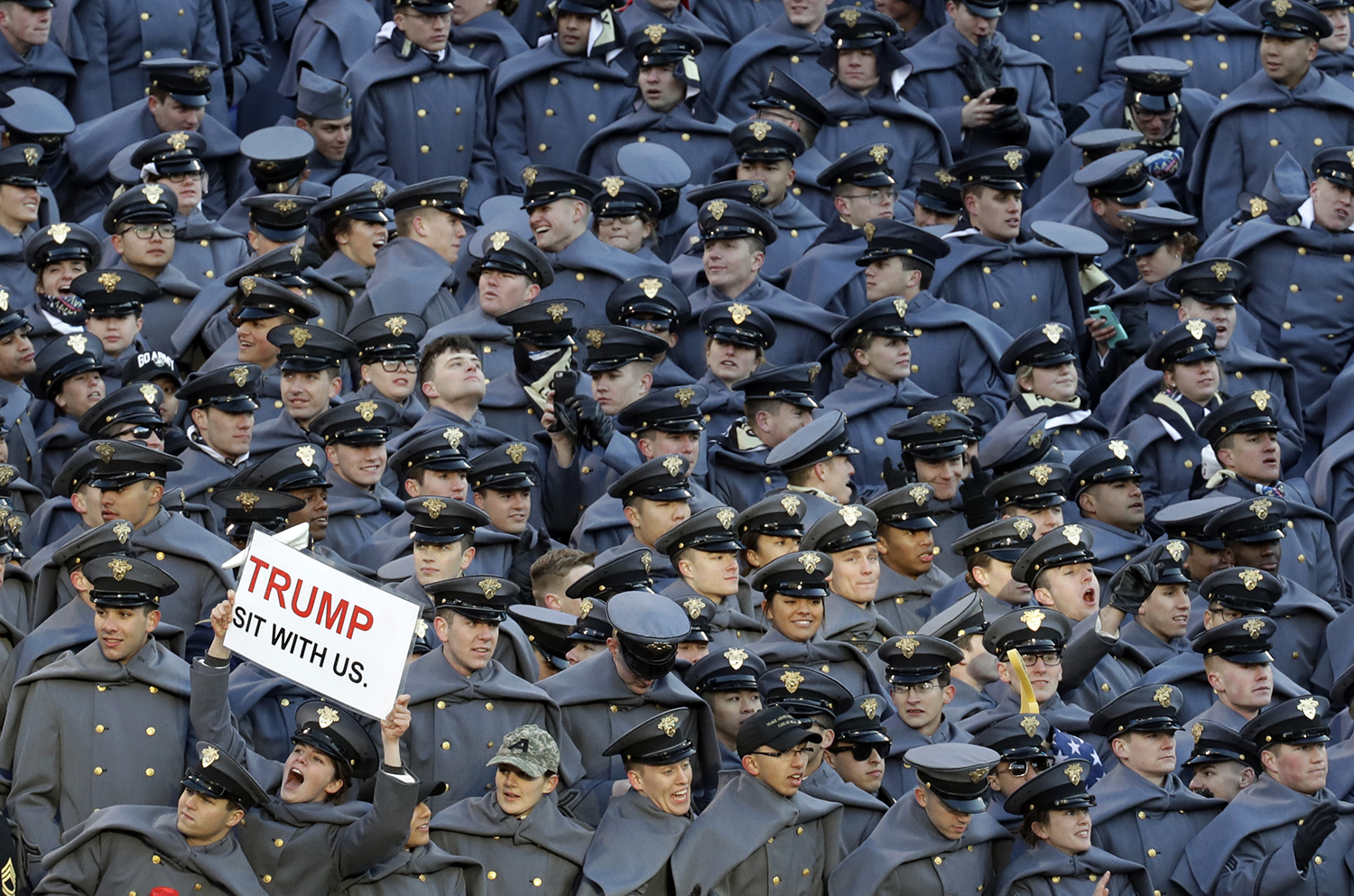 An Army Cadet displays a sign for President-elect Donald Trump during the first half of the Army-Navy NCAA college football game in Baltimore, Saturday, Dec. 10, 2016. (AP Photo/Patrick Semansky)