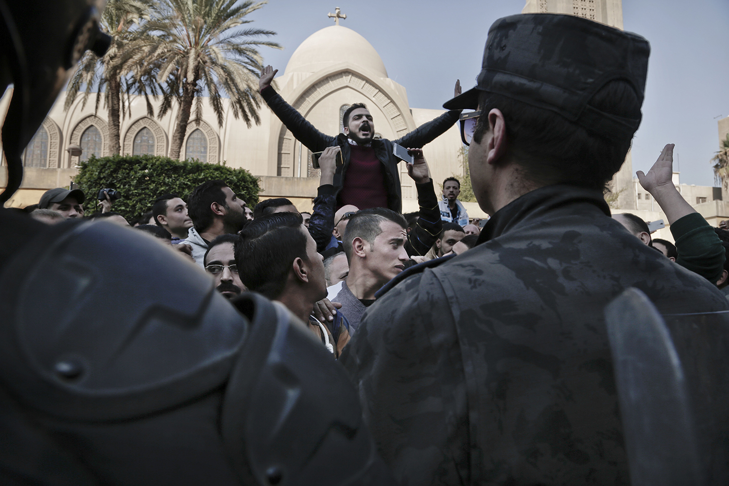 Coptic Christians chant slogans during a protest outside the St. Mark Cathedral in central Cairo, following a deadly bombing, Sunday, Dec. 11, 2016. The blast at Egypt's main Coptic Christian cathedral killed dozens of people and wounded many others on Sunday, according to Egyptian state television, making it one of the deadliest attacks carried out against the religious minority in recent memory. (AP Photo/Nariman El-Mofty)