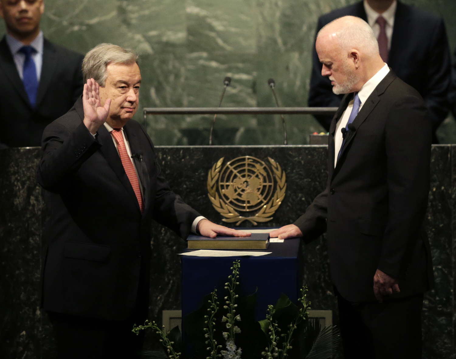 The United Nations Secretary-General designate Antonio Guterres, left, is sworn in by Peter Thomson, president of the UN General Assembly, at U.N. headquarters, Monday, Dec. 12, 2016. (AP Photo/Seth Wenig)