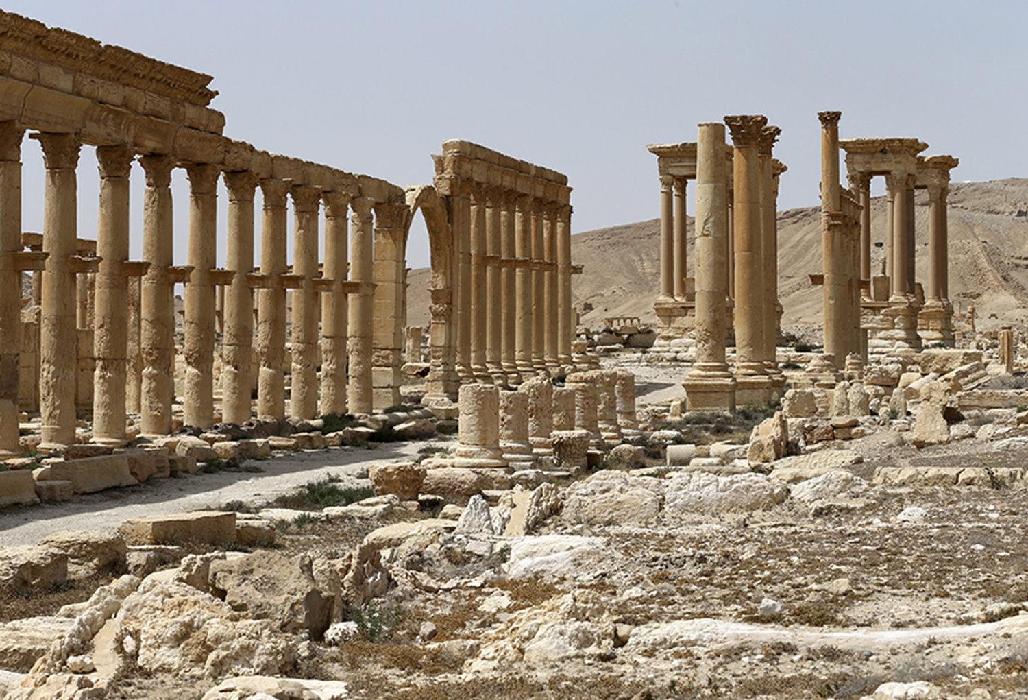 This file photo taken April 8, 2016 and provided by Russian Defense Ministry press service, shows the ancient ruins in Palmyra, Syria. Palmyra, the archaeological gem that Islamic State fighters retook Sunday, Dec. 11, 2016, from Syrian troops is a desert oasis surrounded by palm trees, and a UNESCO world heritage site, that boasts 2,000-year-old towering Roman-era colonnades and priceless artifacts. It is also a strategic crossroads linking the Syrian capital, Damascus, with the country's east and neighboring Iraq. (Russian Defense Ministry Press Service Photo via AP, File)