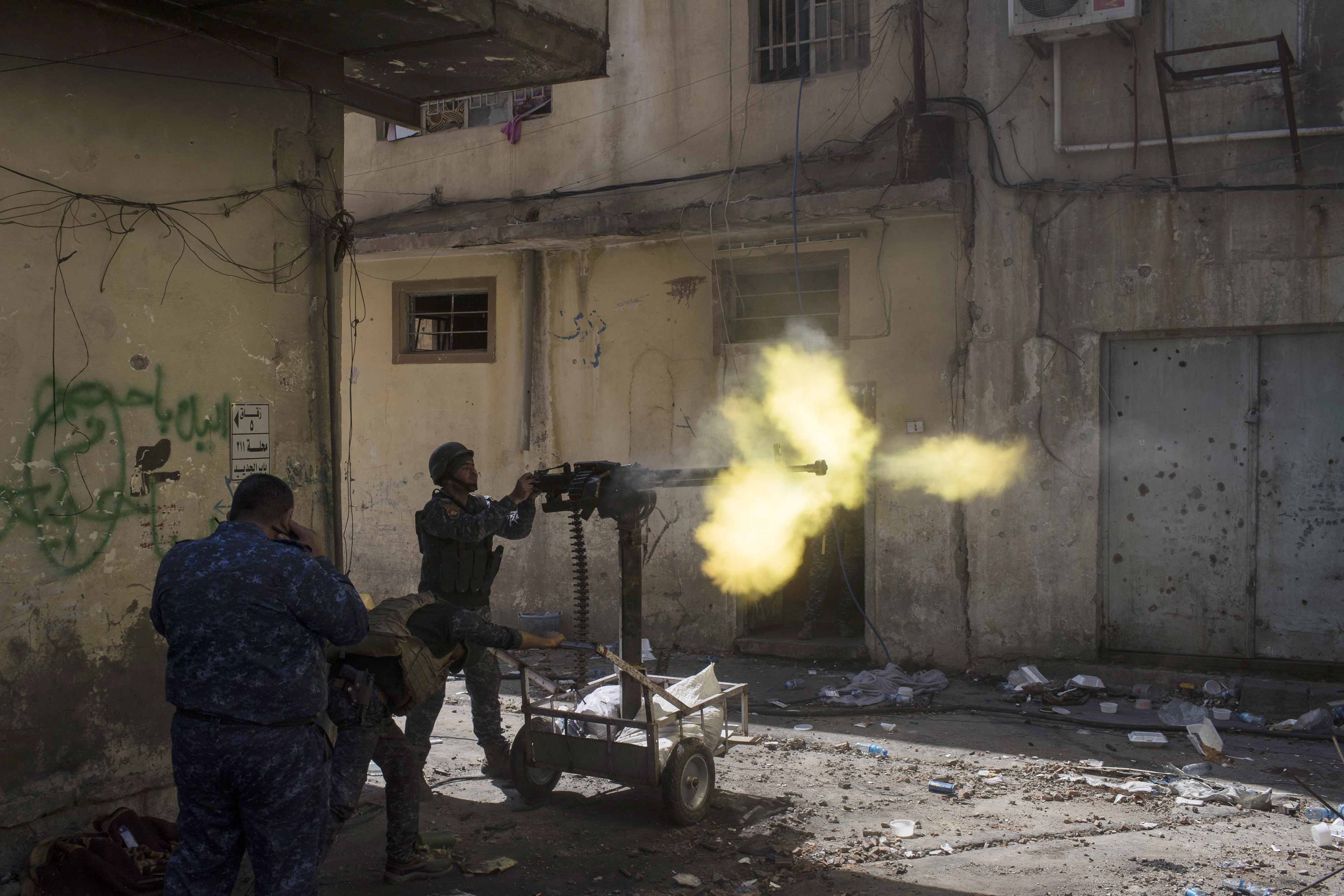 Federal policemen fire towards Islamic State positions in the old city during fighting on the western side of Mosul, Iraq, Thursday, March 30, 2017. (AP Photo/Felipe Dana)