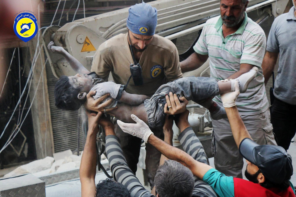 ap foto : uncredited : file -- in this tuesday, sept. 27, 2016, file photo, provided by the syrian civil defense group known as the white helmets, shows a civil defense worker carrying the body of a child after airstrikes hit al-shaar neighborhood in aleppo, syria. nearly 100 children were killed in a single week in aleppo as syrian and russian warplanes sought to bombard into submission the rebel eastern districts of the city that have held out against syrian government forces for five years. without hope for the future, no regular schooling and little access to nutritious food, the children of aleppo and their parents struggle to survive and fear the threat an imminent ground offensive. (syrian civil defense white helmets via ap, file) ap provides access to this file image posted on tuesday sept. 27, 2016 by the syrian civil defense group known as the white helmets which has been verified and is consistent with other ap reporting. logo must remain intac mideast syria children of alepp automatarkiverad