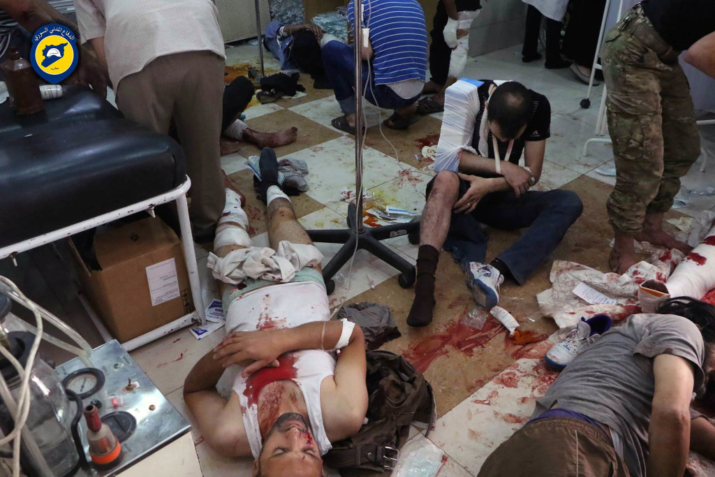 ap foto : uncredited : in this photo provided by the syrian civil defense group known as the white helmets, shows wounded men receiving treatment at a local clinic after airstrikes hit in aleppo, syria, saturday, sept. 24, 2016. syrian government forces captured a rebel-held area on the edge of aleppo on saturday, tightening their siege on opposition-held neighborhoods in the northern city as an ongoing wave of airstrikes destroyed more buildings. (syrian civil defense white helmets via ap) ap provides access to this image posted by the syrian civil defense group known as the white helmets which has been verified and is consistent with other ap reporting. logo must remain intac mideast syri automatarkiverad