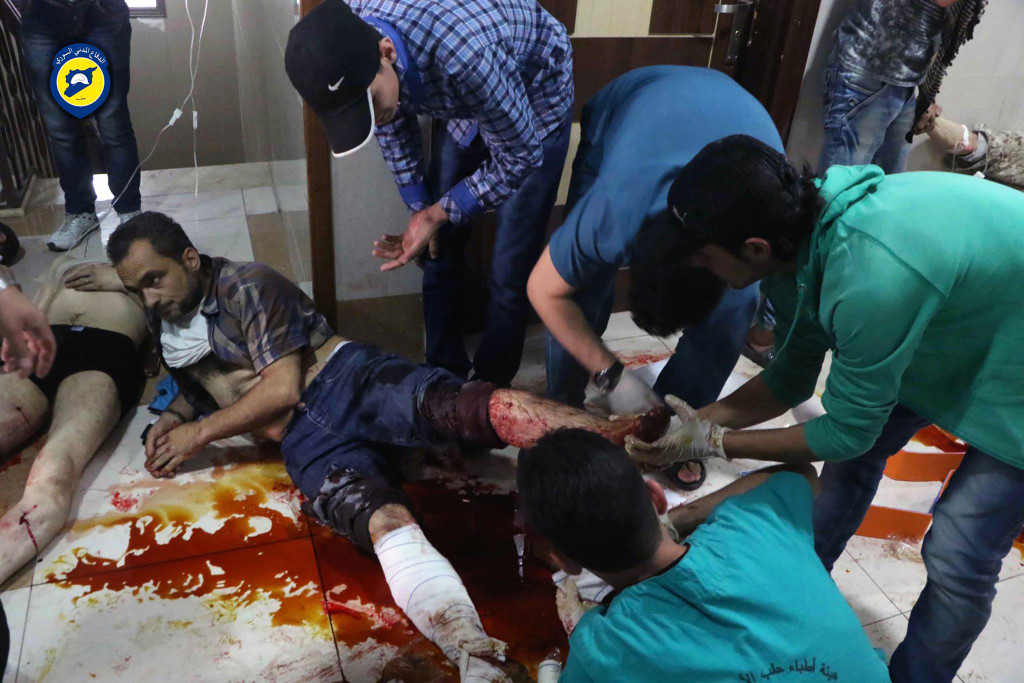 ap foto : uncredited : this photo provided by the syrian civil defense group known as the white helmets, shows victims of airstrikes receiving treatment on the floor of a clinic, in aleppo, syria, sunday, sept. 25, 2016. a broad coalition of syrian rebels denounced international negotiations for peace as meaningless on sunday, as the u.n. security council prepared to convene an emergency meeting about the spiraling violence in syria. (syrian civil defense white helmets via ap) eds note: graphic content. ap provides access to this ho image posted by the syrian civil defense group known as the white helmets which has been verified and is consistent with other ap reporting. logo must remain intac mideast syri automatarkiverad