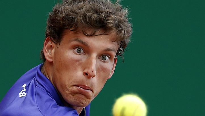 22-årige Pablo Carreno Busta blev tillplattad av regerande mästaren Novak Djokovic.