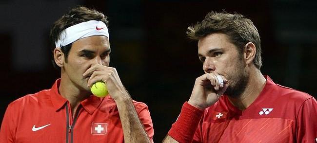 Roger Federer och Stan Wawrinka är kollegor i landslaget – nu slåss de om en finalplats i World Tour Finals.