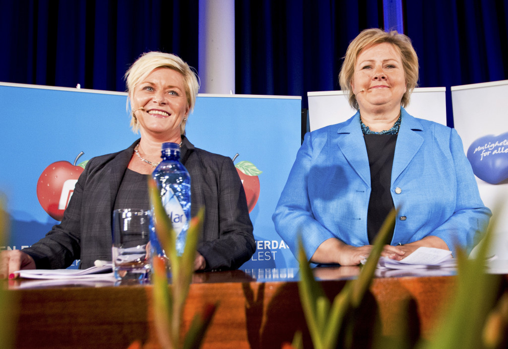 ap foto : vegard grott : chairman of the norwegian conservative party, erna solberg, right, and chairman of the progress party, siv jensen attend a media event in sunnvollen, norway, monday oct. 7, 2013, to announce that they have agreed on a platform to form a new government in norway. the new government is expected to take office on or around october 18, 2013. (ap photo / vegard grott,  ntb scanpix) norway out / tt / kod 436 norway ou norway governmen automatarkiverad