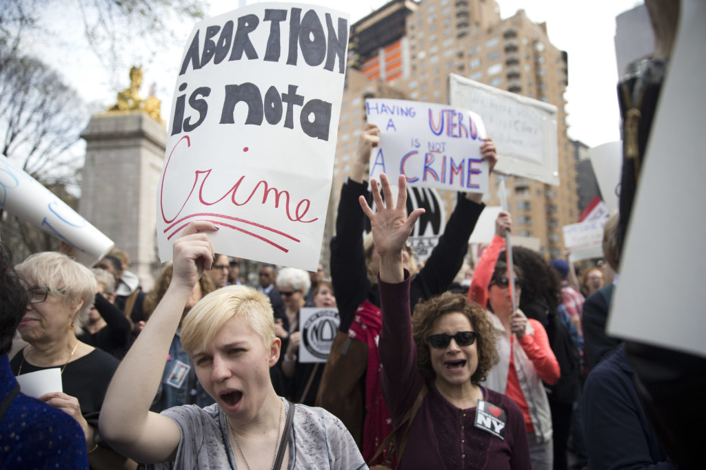 ap foto : mary altaffer : kayla forshey, left, participates in a rally to condemn republican presidential candidate donald trump's remarks about women and abortion thursday, march 31, 2016, in new york. (ap photo/mary altaffer) gop 2016 trump abortio automatarkiverad