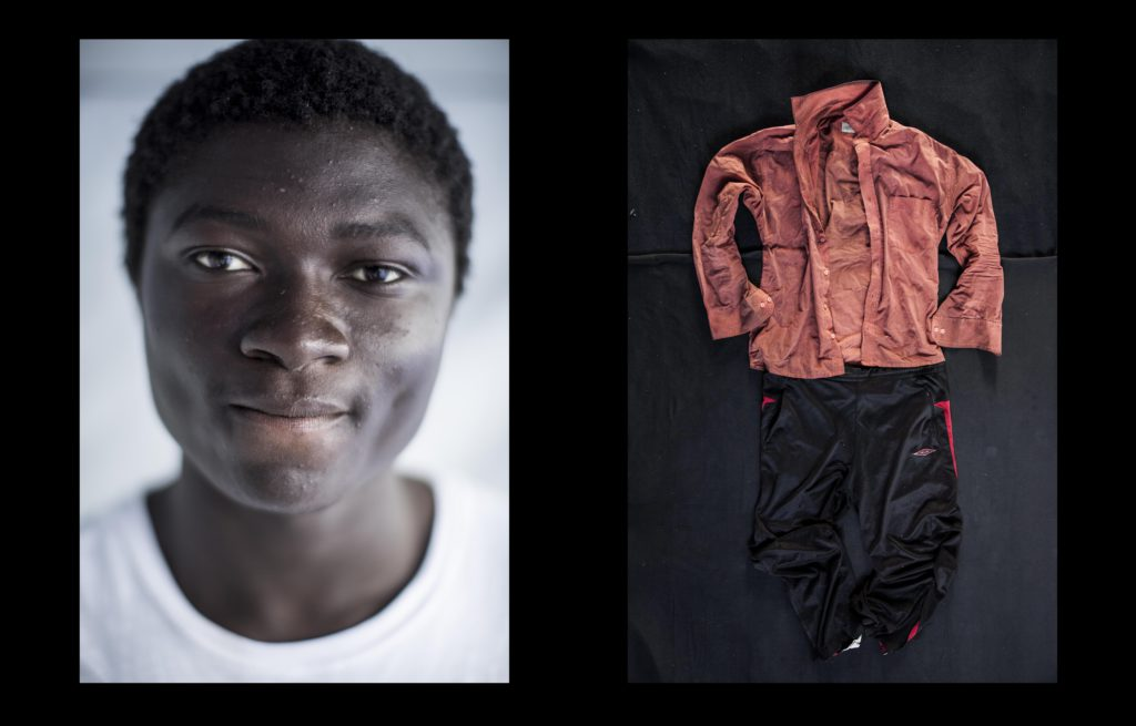 foto : narciso contreras : michael moss kaltun. sierra leone. 18 yo. aquarius sos med. july 24, 2017.  michael moss fled poverty in sierra leone in 2016. he was arrested, imprisoned and got shot as he tried to escape while was being deported to sabha, in the south of libya. many of his gambian friends were killed, although he was shot he survived. after recovered from his wounds michael moss went to sabratah and dealt with traffickers. he was taken onto a dinghy boat towards europe for 250 dollars, once he reached the international waters he was rescued along with other hundreds of migrants.   ??i crossed the desert from niger into libya. it?s a very difficult journey. there is a lot of people coming to the niger desert just to die. the desert is very dangerous because the heat. we did the trip by hilux trucks. the trucks speed up without stop. they stop just when there are dead people. people doing the trip in the desert need water. what is available on the trucks is not enough for all of people. thus, there are too many people